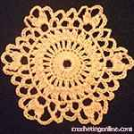 This lacy hexagon can ruffle with the right yarn and with the clusters